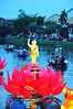 River god (Roving I) Tags: decorations lotusflowers oildrums figures buddhism festivals evening events rivers boats tourism tourists dusk sunset hoian vietnam vertical