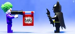 Bang vs Batterang (Jezbags) Tags: toys toy lego legos legodc legobatman minifigure minifigures macro macrophotography macrodreams macrolego canon60d canon 100mm closeup upclose batman batterang joker bang gun green purple black