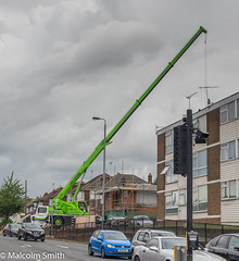 Big Lift (M C Smith) Tags: crane road housing houses flats construction lifting cars traffic sky blue clouds white trees green pentax k3 aerials