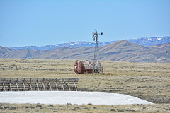 Still Snow (RootsRunDeep) Tags: windmill tank rust ruin decay prairie snow fence drift spring wyoming happywindmillwednesday