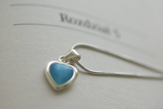 another chapter ... (mariola aga) Tags: book jewelry chain heart macro depthoffield closeup white blue turquoise whitebackground thegalaxy