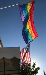 Two Flags over America:  Total 21,091,600 views (LarryJay99 ) Tags: blue iphone7 gayflag oldglory rainbowflag photostream unitedstatesflag flickr colors gaybar bluesky urban flags southflorida iphone7plusbackdualcamera399mmf18
