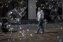 Bubbles (Leanne Boulton) Tags: urban street candid portrait streetphotography candidstreetphotography streetlife fun funny humour happy bubbles bubble man male face facial expression eyecontact candideyecontact walking framing reflection refraction sunlight naturallight outdoor light shade shadow city scene human life living humanity society culture canon canon5d 5dmarkiii 70mm ef2470mmf28liiusm color colour glasgow scotland uk