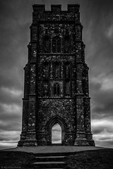 Monolithic (Anthony P.26) Tags: architecture category england external glastonbury glastonburytor places somerset travel building structure mono blackandwhite blackwhite whiteandblack bw monochrome placeofworship steps path cloudy clouds cloudysky grey greyclouds greysky doorway portal tower canon canon70d canon1585mm