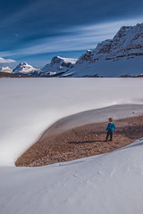 Bow Lake Playground (robertdownie) Tags: canada sky lake frozen boy mountains winter water cold beach blue clouds rocks isolated white snow small mountain ice wonderland playground alberta national park endless banff bow