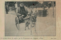 Un grand blesse de Guerre.  WWI France soldier with both legs amputated riding a dog cart on avenue des anglais in Nice France. Photo by Joller.  PUBLISHED  1932 in la patrie Suisse (Yvonne Thompson) Tags: amputees soldier wwi disability