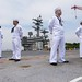 Sailors stand at parade rest on the flight deck of USS Ronald Reagan.