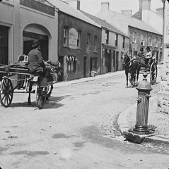 Street in Larne, Co. Antrim (National Library of Ireland on The Commons) Tags: thejoshuahhargravecollection nationallibraryofireland photographicarchive larne coantrim ulster northernireland horses carts bowler tophats countyantrim mainstreet uppercrossstreet lowercrossstreet townhall larnetownhall villagepump waterfountain gingles owencompany jauntingcar crossstreet waterpump