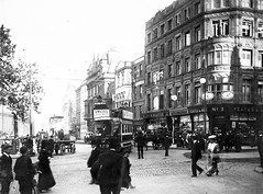 Trams and pedestrians on Nassau Street, viewed from Grafton Street (National Library of Ireland on The Commons) Tags: clarkephotographiccollection jjclarke johnjosephclarke 1879–1961 brianpclarke–donor nationallibraryofireland trampeople trinitycollege driver hats yeatesno2 amstel jeyes yeates old harris oldharriss pillarbox tram 129 johnmorton shops dublin racine graftonstreet nassaustreet postbox suffolkstreet