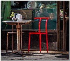The red chair (Hugh Stanton) Tags: steel chair urban seat cafe appicoftheweek
