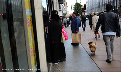 `1976 (roll the dice) Tags: london westminster westend w1 oxfordstreet creepy scared mad sad happy burka burqa hidden face veiled muslim fashion shops shopping streetphotography pretty sexy girl mystery people natural religion portrait stranger candid urban england dark eyes uk art classic canon tourism dog lights traffic glass window shadows reflection unaware unknown reaction primark black bags kuwait hijab niqab