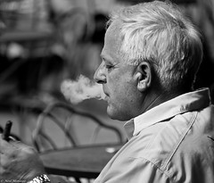 To inhale or not ! (Neil. Moralee) Tags: neilmoralee usa2017neilmoralee man face portrait profile black white mopno cigar smoke smoker tobacco ash monochrome new orleans street candid pleasure inhale breath sunshine taste hamlet castelle churchill stogie stoggie neil moralee nikon d7200 bw bandw blackandwhite cafe table sitting