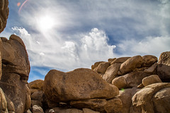 Rock Formation in Joshua Tree NP (aparlette) Tags: nationalpark lensflare sunlight landscape sun rockformation joshuatreenationalpark clouds desert flare joshuatree rock vacation california unitedstates us
