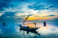 Fishing Boat (guppii) Tags: beach sea ocean sky blue sunrise sun boat clouds sony kitlens 1855mm nd64x gnd blackcard landscape nature surabaya kenjeran indonesia