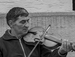 Getting the right tune (Alex Ex08) Tags: people street photography man fiddle
