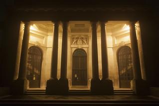 Ashton Memorial eastern portico, Williamson Park, Lancaster, UK, at night, in fog