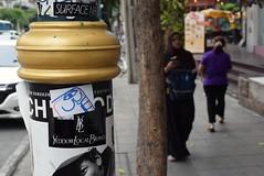 Bangkok Surface Noise (jcbkk1956) Tags: worldtrekker muslim thai asian women 35mmf18 nikkor nikon dof candid thonglo thailand bangkok street graffiti stickers