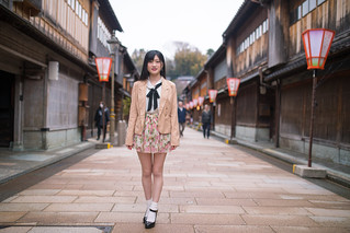 Portrait of young woman  on raditional Japanese shopping street