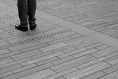 Waiting to pass (anhem.home) Tags: trespass waiting bw monochrome legs shoes