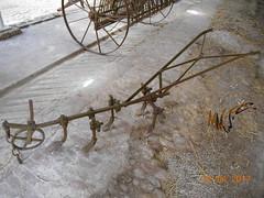 Farming past (iv) (Landstrider1691) Tags: farm machinery farmmachinery antiquefarmequipment oldfarmequipment bygonefarm plough cultivator hayrake hay rake wheel woodenwheel pasttimes old antique