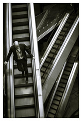 Going Down - in explore (Dave Fieldhouse Photography) Tags: monochrome urban city street streetphotography metropolis modern modernarchitecture birmingham westmidlands fuji fujifilm fujixpro2 wwwdavefieldhousephotographycom people escalator commuter worker staff portrait chrome indoors