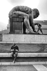 Newton and friend (halifaxlight) Tags: england london newton eduardopaolozzi sculpture statue britishlibrary figure mobilephone cellphone street bw