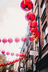 Mainstream Chinese balls in London's Chinatown (xavi_julia) Tags: london streetphotography olympus canon 24mm f28 grain vintage