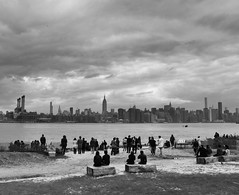 Smorgasburg (paleyphotos) Tags: flickrelite flickr blackwhite urban street people williamsburg building empirestate cityscape skyline newyork brooklyn nyc bw new york water beach sky city river