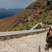 Donkeys carrying tourists up the 550 steps from the port to the town of Fira in Santorini, Greece