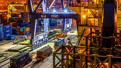 Loading of a container ship (Juergen Huettel Photography) Tags: jhuettel ship container water night bluehour laem chabang sea tourism