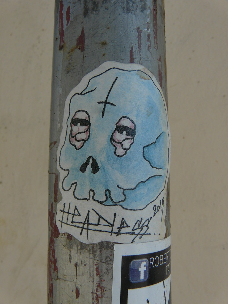 Headless sysli tags denmark copenhagen graffiti streetart skull blue wall drainpipe sticker