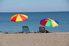 Beach Umbrellas (craigsanders429) Tags: umbrella umbrellas beachumbrella lakeerie greatlakes lakeerieinpennsylvania beaches sandbeaches presqueislestatepark water waterways lakes onthebeach summer