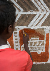 Young man painting the wall of a traditional ethiopian house, Kembata, Alaba Kuito, Ethiopia (Eric Lafforgue) Tags: abyssinia adolescent africa african alaba architecture art artist building color culture day decorated decoration depiction eastafrica ethiopia ethiopian ethnic geometric home hornofafrica house housing hut illustration kulito mural naive oneperson outdoors painted painter painting people poverty skill teenager toukoul tukul vertical village work working youngadult ethio163441 alabakuito kembata