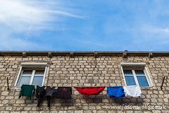 Looking up at laundry on the line (wellsie82) Tags: croatia medieval mediterraneanculture oldtown architecture balkans bluesky building buildingexterior builtstructure chores city citylife cityscape clearsky colourimage croatianculture dalmatia day domesticlife drying dubrovnik dubrovnikneretva dubrovnikoldtown easterneuropeanculture europe facade famousplace formeryugoslavia historicdistrict history holiday house internationallandmark landscapeformat laundry lifestyles mediterranean nationallandmark outdoors pearloftheadriatic sky southerneurope sunlight sunny tourism town townscape travel traveldestinations travelling unescoworldheritagesite urban vacations washingline