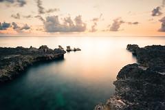 Setting At West Bay (Tim Drivas) Tags: sunset longexposure caymanislands grandcayman beach shore caribbean vacation holiday ocean outdoors