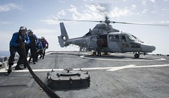 Sailors retract a refueling line from a French helicopter. (Official U.S. Navy Imagery) Tags: ussrossddg71 ddg71 ross sailors frenchnavypanther jeanbartd615 refuel mediterraneansea usa