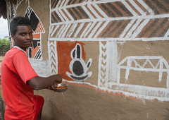 Young man painting the wall of a traditional ethiopian house, Kembata, Alaba Kuito, Ethiopia (Eric Lafforgue) Tags: abyssinia adolescent africa african alaba architecture art artist building color culture day decorated decoration depiction eastafrica ethiopia ethiopian ethnic geometric home horizontal hornofafrica house housing hut illustration kulito lookingatcamera mural naive oneperson outdoors painted painter painting people poverty skill teenager toukoul tukul village waistup work working youngadult ethio163433 alabakuito kembata