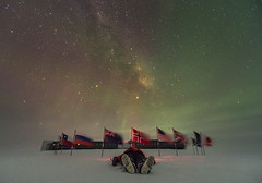 Watching the Milky Way (redfurwolf) Tags: southpole southpolestation antarctica milkyway stars night nightsky auroraaustralis aurora flags snow human person building outdoor sky redfurwolf sonyalpha a99ii sal1635f28za