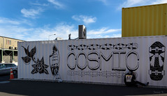 Artist at Work (Jocey K) Tags: cbd newzealand christchurch nikond750 streetart artist mural artwork person shippingcontainer brush sky clouds words