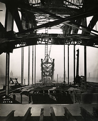 View along the Tyne Bridge from the Gateshead side (Tyne & Wear Archives & Museums) Tags: tynebridge tyneside northeastengland bridges newcastleupontyne gateshead civilengineering blackandwhitephotograph girders construction industrialheritage industry buildingthetynebridge digitalimage archives northeastofengland unitedkingdom side gatesheadside newcastleside 27january1928 northeast iconiclandmark jamesbaconsons newcastle structure crossing rail march1927tooctober1928 jamesgeddie chiefassistantengineer dormanlongcoltd middlesbrough sky land city urban crane blur grain ladder beam chimney smoke buildings wall window roof engaging interesting unusual label production shadow daylight river progress economy infrastructure