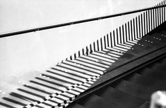 Lines and shadow @ Haarlem (PaulHoo) Tags: line pattern texture shadow abstract agfa apx 35mm film analog leica m3 rangefinder bw blackandwhite monochrome city urban 2017 sun bright stairs tunnel