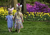 Springtime (crabsandbeer (Kevin Moore)) Tags: candid family flowers garden gardens kids people sherwoodgardens spring tulips sisters bunnyears easter childhood girls baltimore nature colorful holdinghands rabbit