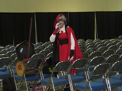 IMG_1564 (kennethkonica) Tags: indianacomiccon costumes culture people persons indianapolis indiana indy c canonpowershot canon midwest usa america cellphone talking hoosier global random red mask woman
