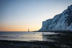 Beachy Head At Dusk (DanRansley) Tags: beachyhead britain danransleyphotography eastsussex england englishchannel greatbritain southdowns uk beach chalk cliffs coast lighthouse sea seaside sky evening sunset dusk water southcoast tide
