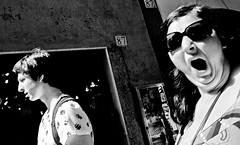 The Scream!! (Baz 120) Tags: candid candidstreet candidportrait city candidface candidphotography contrast street streetphoto streetcandid streetphotography streetphotograph streetportrait rome roma romepeople romestreets romecandid europe women monochrome monotone mono blackandwhite bw noiretblanc urban voigtlandercolorskopar21mmf40 voightlander leicam8 leica life primelens portrait people unposed italy italia girl grittystreetphotography faces decisivemoment strangers