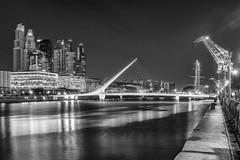 Puente de la Mujer (IRRphotography) Tags: buenosaires bridge blackandwhite blackwhite bw bnw city lights argentina latinamerica river skyline buildings port puerto modero puertomodero crane fuji x100 x100t fujifilm