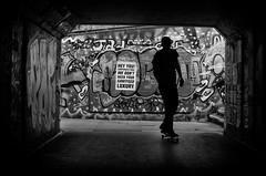 Hey you! corporate fool... (Daz Smith) Tags: dazsmith fujixt20 fuji xt20 andwhite bath city streetphotography people candid portrait citylife thecity urban streets uk monochrome blancoynegro blackandwhite mono graffiti corporatefool poster skaterboy skateborad boy underpass bristol