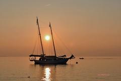 """""""ASPETTANDO L' ATTIMO"""" (Ivo Markes) Tags: iamdifferent nikonitalia nikonclubit water acqua barca sunset tramonto"""