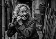 Sink your teeth into life (Frank Busch) Tags: frankbusch frankbuschphotography imagebyfrankbusch photobyfrankbusch apatani arunachalpradesh bw blackwhite blackandwhite india monochrome tribes village woman wwwfrankbuschname