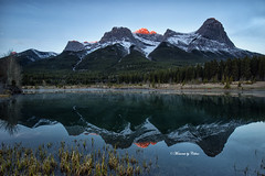 Dawn Glow (Canon Queen Rocks (1,980,000 + views)) Tags: quarrylake landscape lake landscapes lakes nature canada canmore reflections mountains mothernature peaks rockies alberta sky scenery scenic sunrise trees snowcapped ilobsterit momentsbycelinecom
